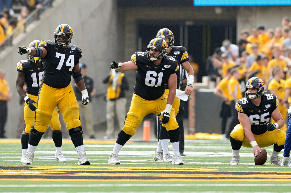 Iowa Hawkeyes offensive lineman Tristan Wirfs (74) and offensive lineman Cole Banwart (61) point before a snap during the second quarter of their game at Kinnick Stadium in Iowa City on Saturday, Sep 28, 2019. (Stephen Mally/hawkeyesports.com)