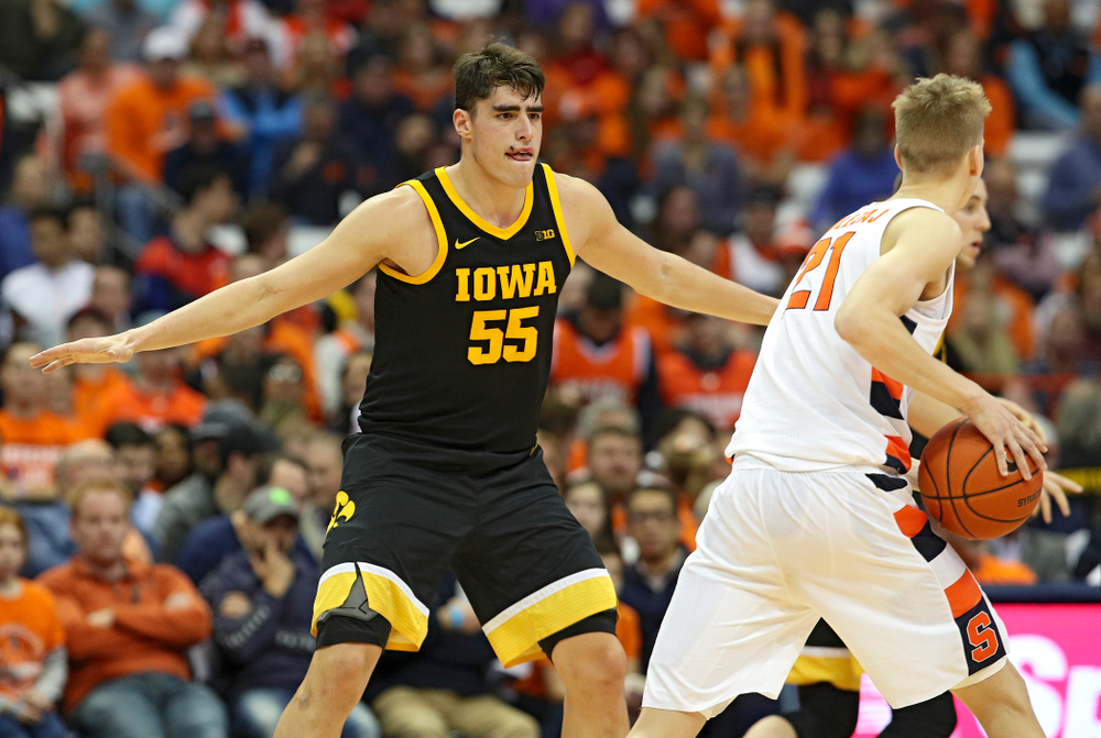 Iowa Hawkeyes center Luka Garza (55) defends during the second half of their ACC/Big Ten Challenge game at the Carrier Dome in Syracuse, N.Y. on Tuesday, Dec 3, 2019. (Stephen Mally/hawkeyesports.com)