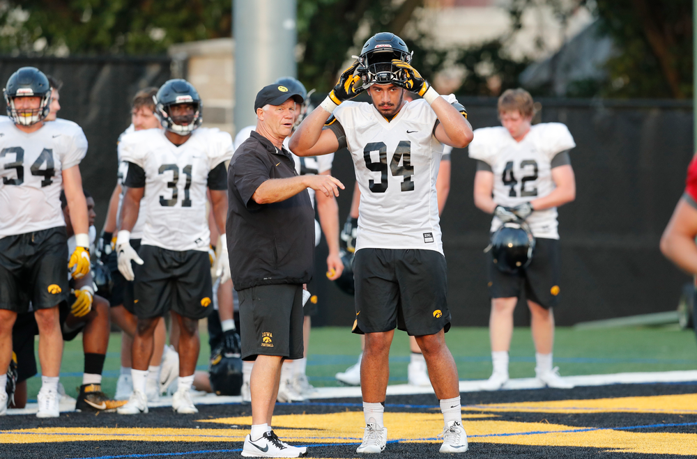 Reese Morgan and defensive end A.J. Epenesa (94)