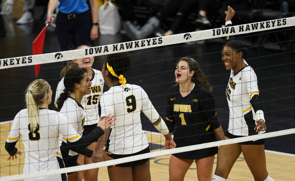 Iowa Hawkeyes setter Brie Orr (7), Iowa Hawkeyes defensive specialist Molly Kelly (1) and Iowa Hawkeyes outside hitter Taylor Louis (16) celebrate after winning a point during a match against Rutgers at Carver-Hawkeye Arena on November 2, 2018. (Tork Mason/hawkeyesports.com)