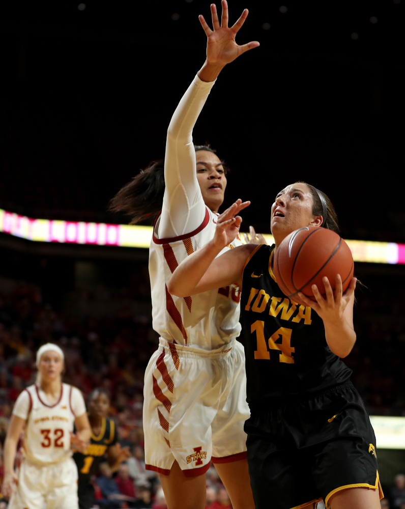 Iowa Hawkeyes forward McKenna Warnock (14) against the Iowa State Cyclones Wednesday, December 11, 2019 at Hilton Coliseum in Ames, Iowa(Brian Ray/hawkeyesports.com)