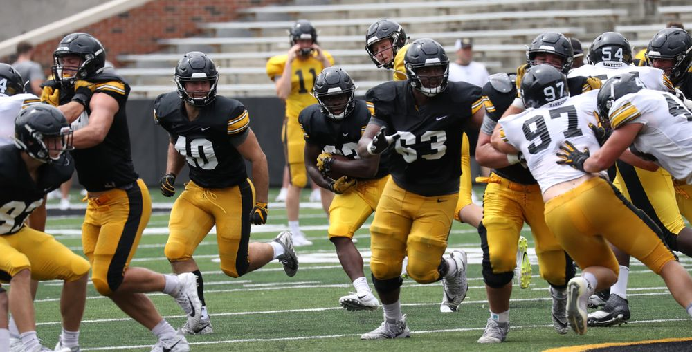 FB Turner Pallissard (40) and OL Justin Britt (63) clear the way for RB Shadrick Byrd (23)