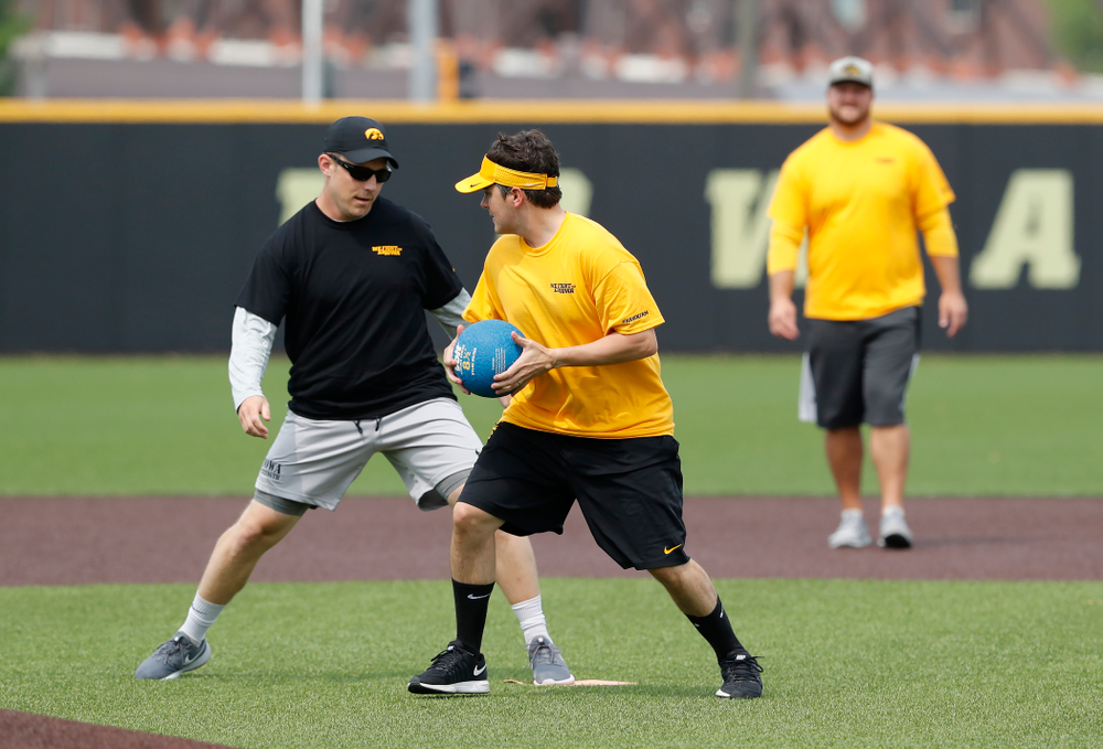 Asst. Director Compliance Henry Archuleta and director of Football New Media Max Allen during the Iowa Student Athlete Kickoff Kickball game  Sunday, August 19, 2018 at Duane Banks Field. (Brian Ray/hawkeyesports.com)