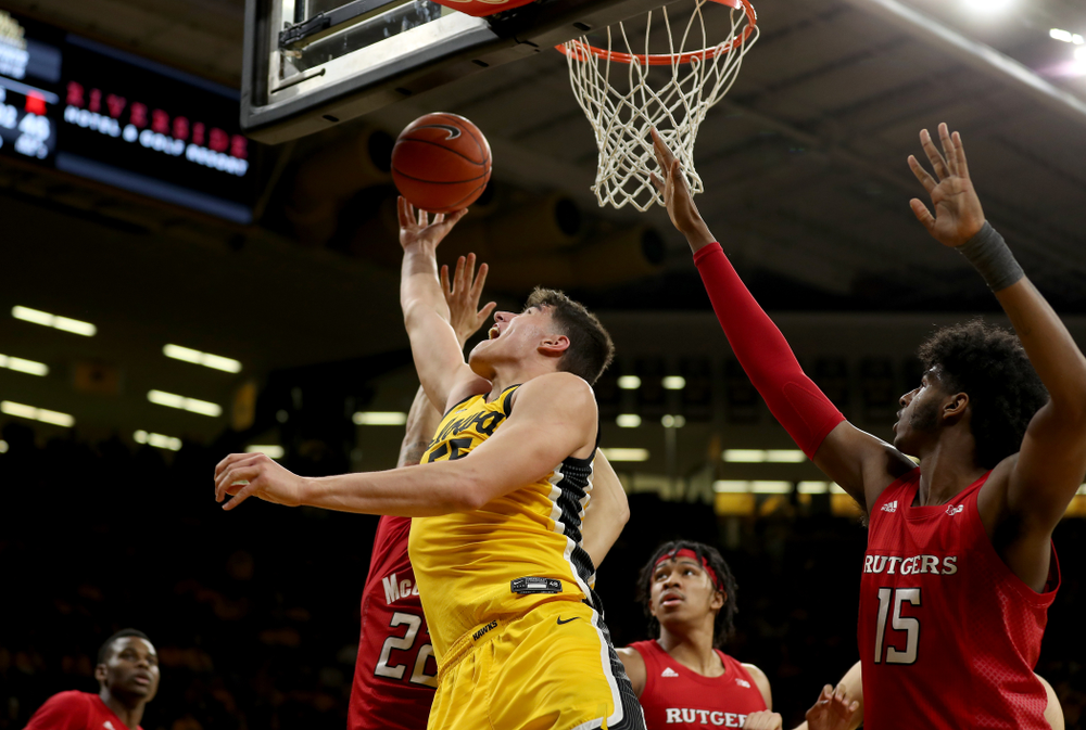 Iowa Hawkeyes forward Luka Garza (55) goes to the hoop against the Rutgers Scarlet Knights  Wednesday, January 22, 2020 at Carver-Hawkeye Arena. (Brian Ray/hawkeyesports.com)