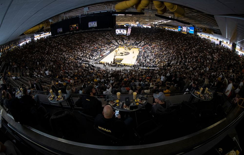 Fans sit in the terrace tables as the Iowa Hawkeyes take on  the Illinois Fighting Illini Sunday, January 20
