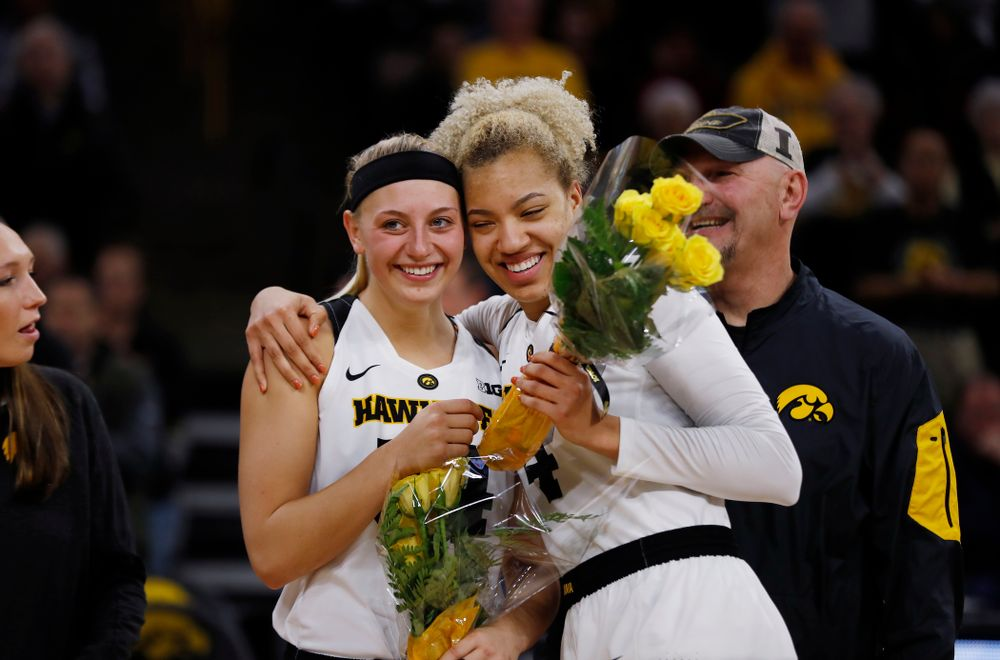Iowa Hawkeyes forward Carly Mohns (34) and forward Chase Coley (4)
