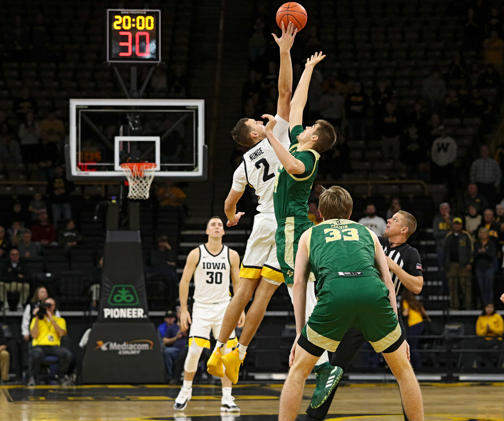 Iowa Hawkeyes forward Jack Nunge (2) gets his hand on the opening tipoff during the first half of their game at Carver-Hawkeye Arena in Iowa City on Sunday, Nov 24, 2019. (Stephen Mally/hawkeyesports.com)