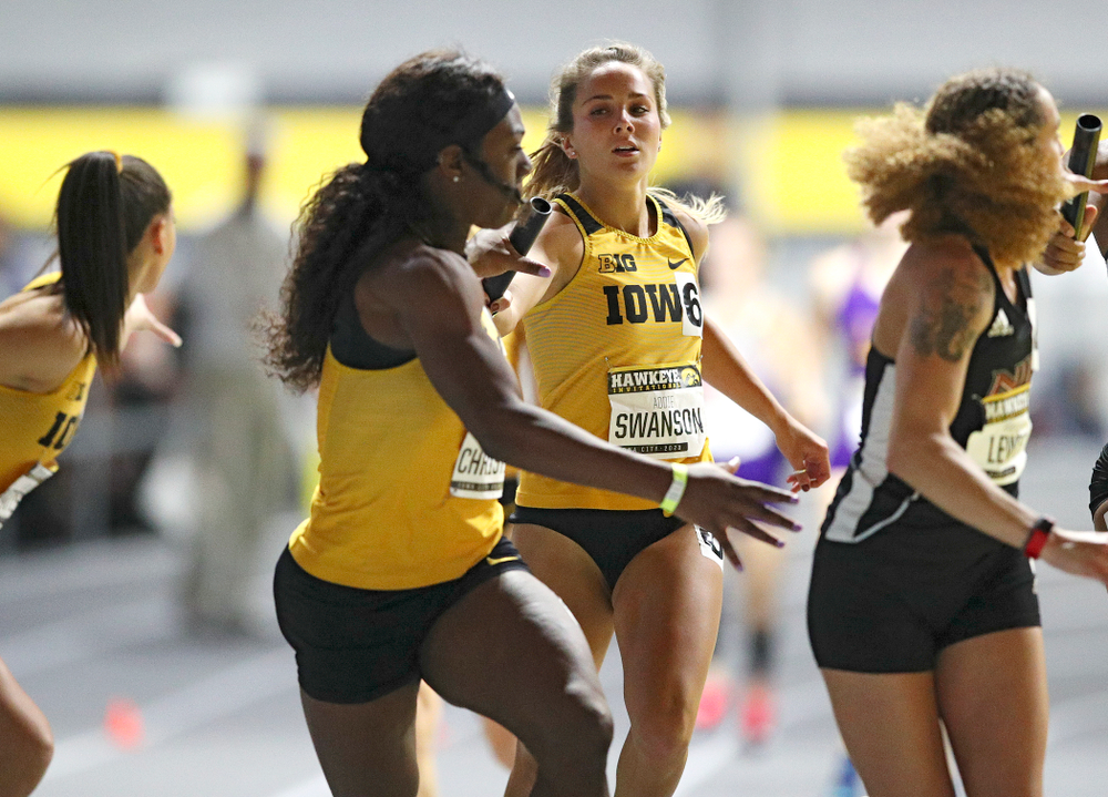Iowa's Addie Swanson (right) hands the baton off to Antonise Christian as they run the women's 1600 meter relay event during the Hawkeye Invitational at the Recreation Building in Iowa City on Saturday, January 11, 2020. (Stephen Mally/hawkeyesports.com)