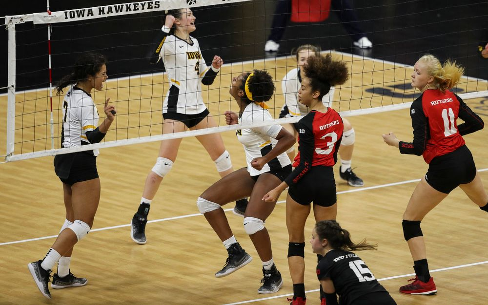 Iowa Hawkeyes setter Brie Orr (7) and Iowa Hawkeyes middle blocker Amiya Jones (9) celebrate after winning match point during a match against Rutgers at Carver-Hawkeye Arena on November 2, 2018. (Tork Mason/hawkeyesports.com)