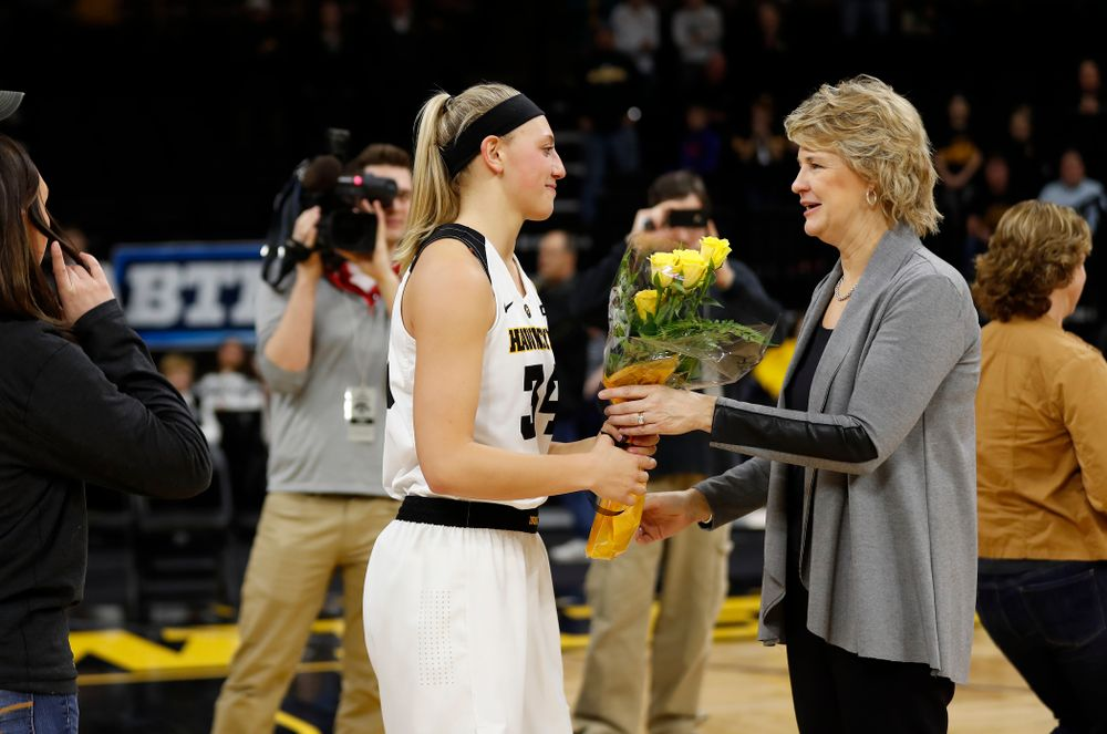 Iowa Hawkeyes forward Carly Mohns (34) and head coach Lisa Bluder