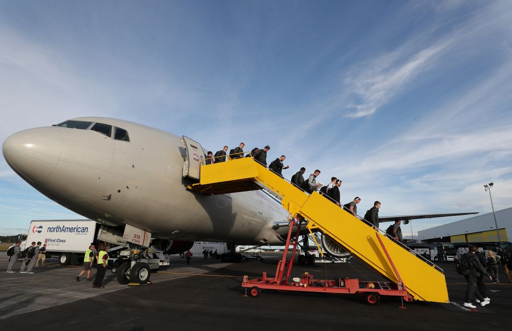 The Iowa Hawkeyes disembark the team plane Wednesday, December 26, 2018 as they arrive in Tampa, Florida for the Outback Bowl. (Brian Ray/hawkeyesports.com)