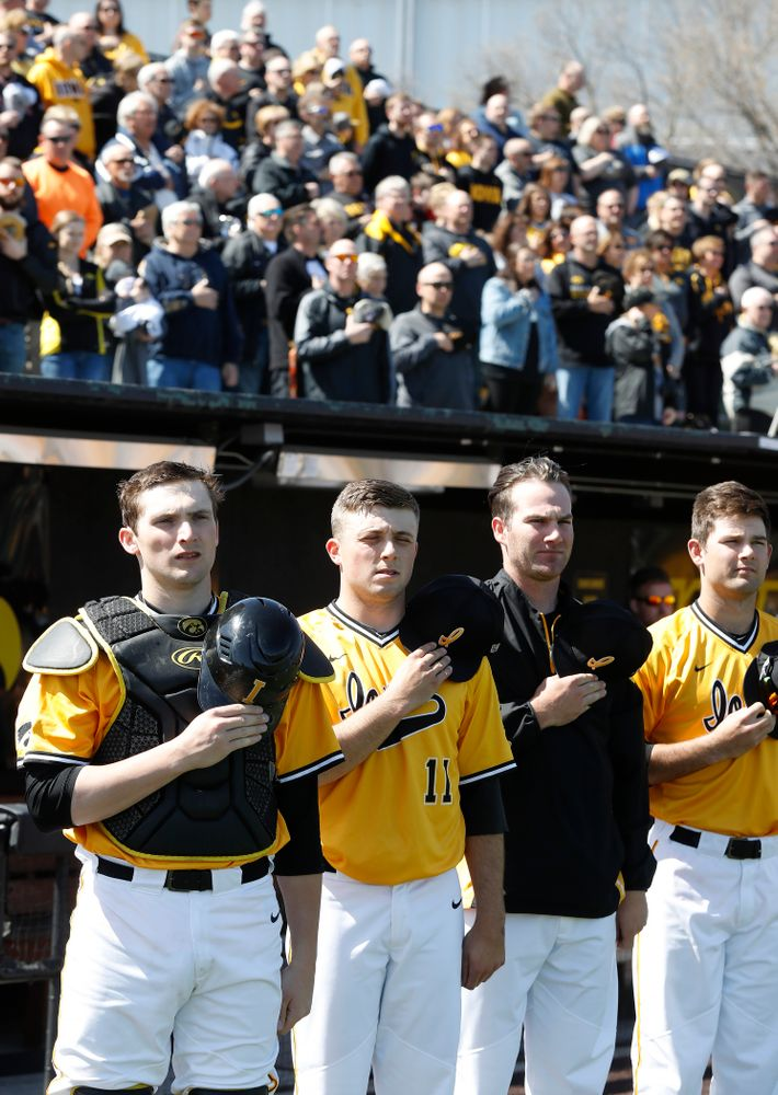 Iowa Hawkeyes catcher Brett McCleary (32), pitcher Cole McDonald (11), and pitcher Nick Allgeyer (24) before their game against the Michigan Wolverines Sunday, April 29, 2018 at Duane Banks Field. (Brian Ray/hawkeyesports.com)