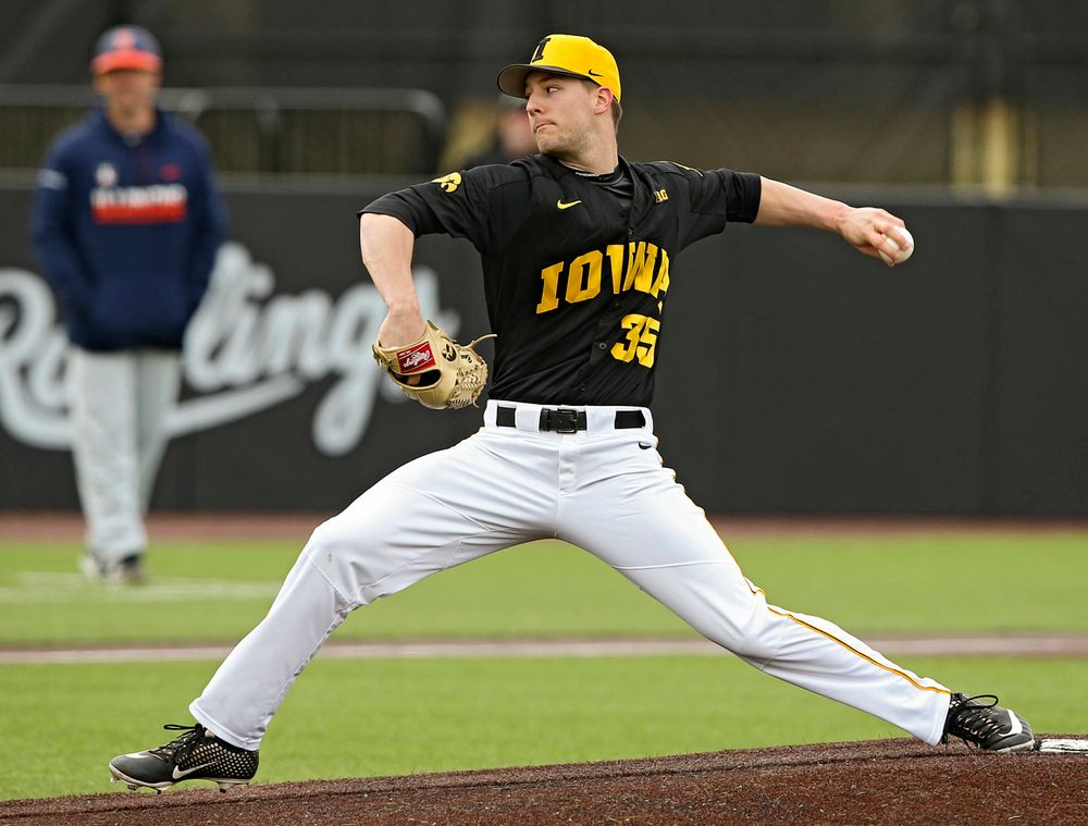 Iowa Hawkeyes pitcher Cam Baumann (35) delivers to the plate during the first inning of their game against Illinois at Duane Banks Field in Iowa City on Saturday, Mar. 30, 2019. (Stephen Mally/hawkeyesports.com)