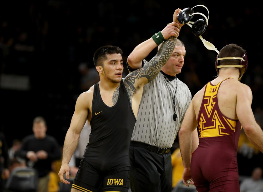 Iowa's Pat Lugo wrestles Minnesota's Brayton Lee at 149 pounds Saturday, February 15, 2020 at Carver-Hawkeye Arena. Lugo won the match 3-2. (Brian Ray/hawkeyesports.com)