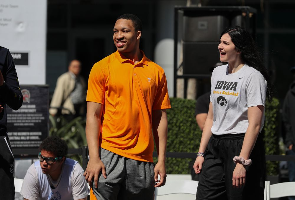 Iowa Hawkeyes forward Megan Gustafson (10) and TennesseeÕs Grant Williams during a Special Olympics event Friday, April 12, 2019 as part of the ESPN College Basketball Awards in the XBOX Plaza at LA Live.  (Brian Ray/hawkeyesports.com)