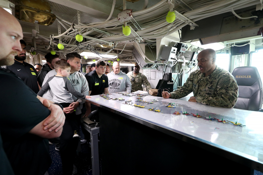 Members of the Iowa Hawkeyes tour the USS Theodore Roosevelt (CVN-71) Tuesday, December 24, 2019 at the Naval Base Coronado (Brian Ray/hawkeyesports.com)