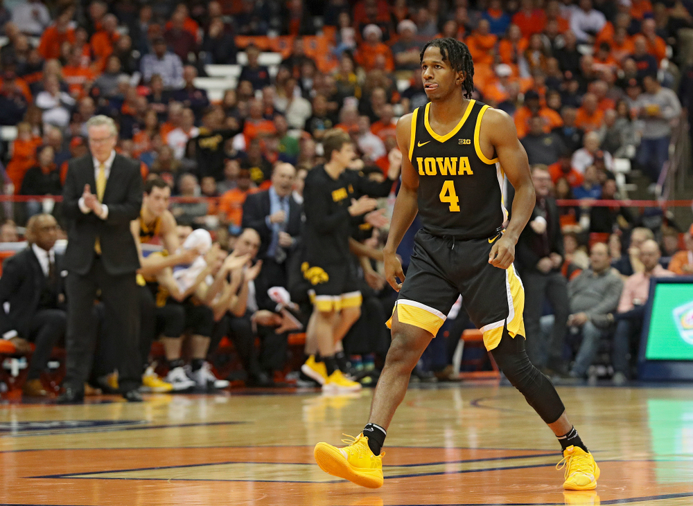 Iowa Hawkeyes guard Bakari Evelyn (4) sticks out his tongue after making a 3-pointer during the first half of their ACC/Big Ten Challenge game at the Carrier Dome in Syracuse, N.Y. on Tuesday, Dec 3, 2019. (Stephen Mally/hawkeyesports.com)