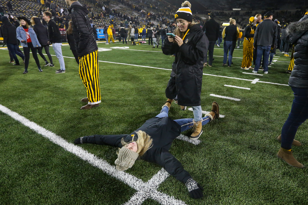 Fans take photos on the field during Iowa football vs Minnesota on Saturday, November 16, 2019 at Kinnick Stadium. (Lily Smith/hawkeyesports.com)