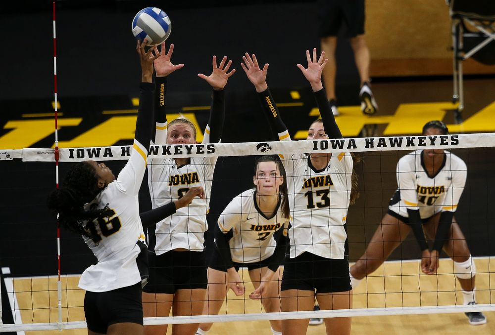 Iowa Hawkeyes right side hitter Reghan Coyle (8), Iowa Hawkeyes middle blocker Sara Wing (13)