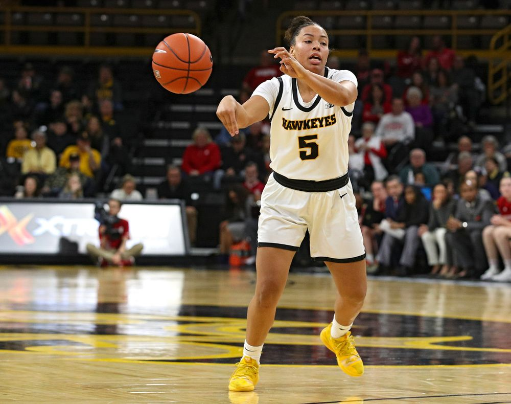 Iowa Hawkeyes guard Alexis Sevillian (5) passes the ball during the third quarter of the game at Carver-Hawkeye Arena in Iowa City on Thursday, February 6, 2020. (Stephen Mally/hawkeyesports.com)