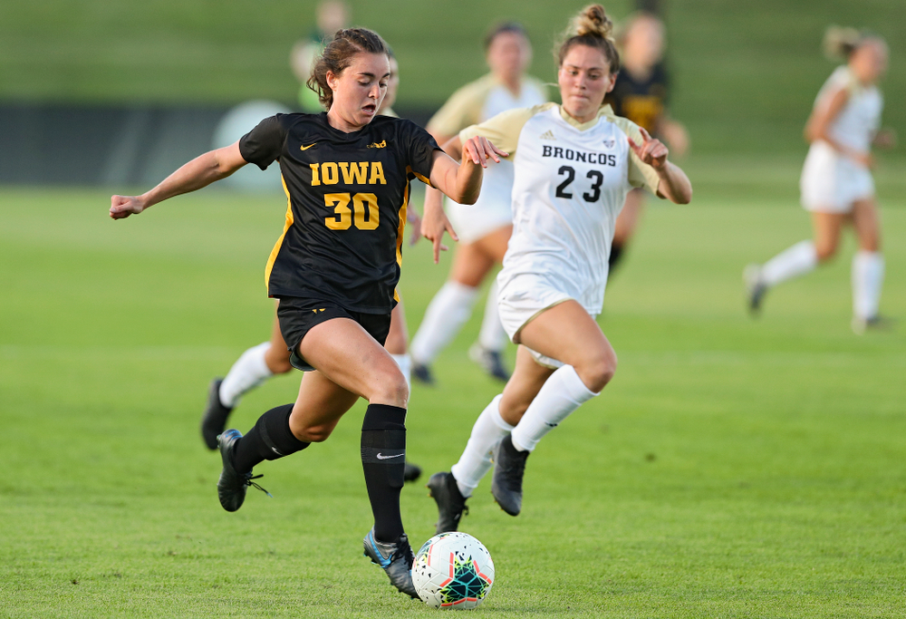 Iowa forward Devin Burns (30) chases down the ball during the first half of their match against Western Michigan at the Iowa Soccer Complex in Iowa City on Thursday, Aug 22, 2019. (Stephen Mally/hawkeyesports.com)