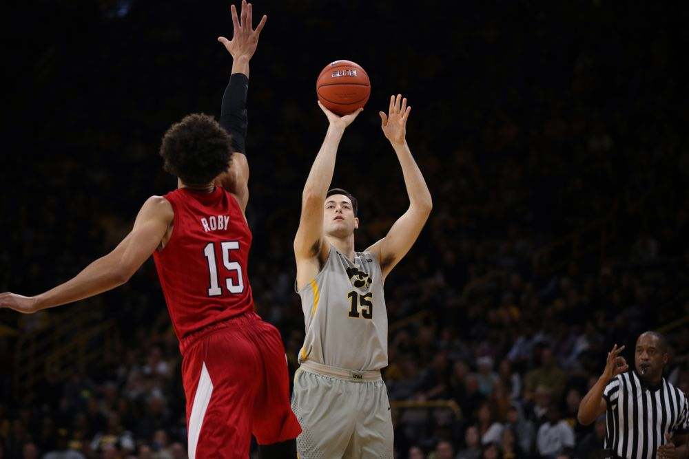 Iowa Hawkeyes forward Ryan Kriener (15) knocks down a three point basket against the Nebraska Cornhuskers Sunday, January 6, 2019 at Carver-Hawkeye Arena. (Brian Ray/hawkeyesports.com)