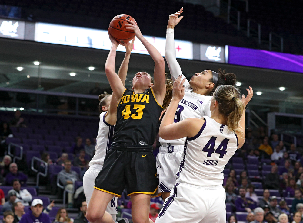 Iowa Hawkeyes forward Amanda Ollinger (43) grabs a rebound during the third quarter of their game at Welsh-Ryan Arena in Evanston, Ill. on Sunday, January 5, 2020. (Stephen Mally/hawkeyesports.com)