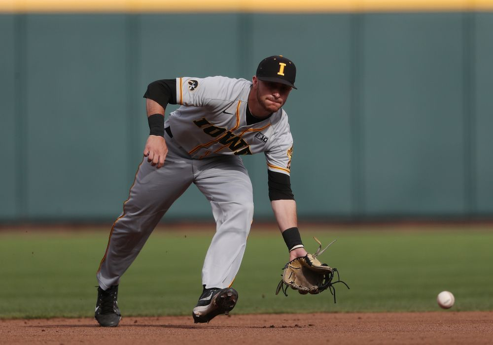 Iowa Hawkeyes Tanner Wetrich (16) fields a ground ball against the Indiana Hoosiers in the first round of the Big Ten Baseball Tournament Wednesday, May 22, 2019 at TD Ameritrade Park in Omaha, Neb. (Brian Ray/hawkeyesports.com)