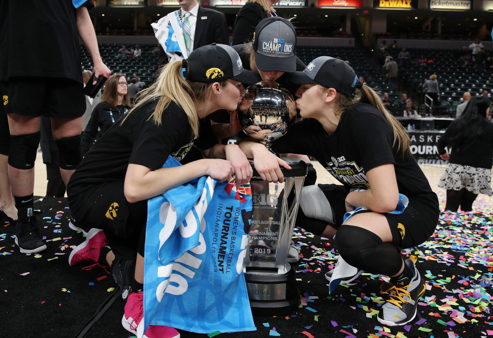 Iowa Hawkeyes guard Makenzie Meyer (3), forward Hannah Stewart (21), and guard Kathleen Doyle (22) celebrate their win against the Maryland Terrapins Sunday, March 10, 2019 at Bankers Life Fieldhouse in Indianapolis, Ind. (Brian Ray/hawkeyesports.com)