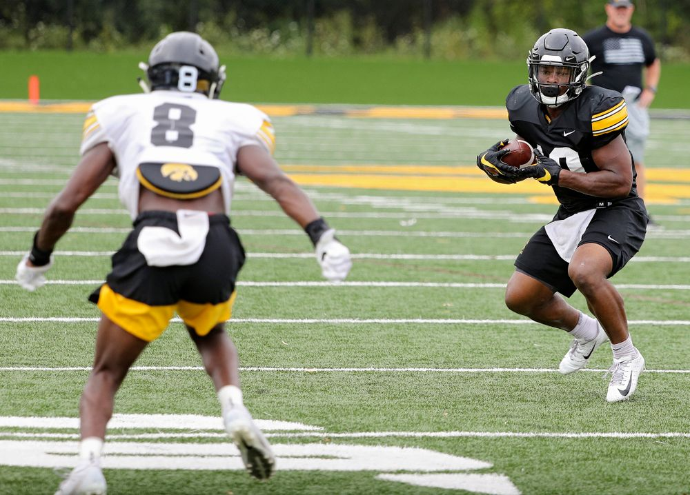 Iowa Hawkeyes running back Mekhi Sargent (10) eyes defensive back Matt Hankins (8) after pulling a pass during Fall Camp Practice No. 15 at the Hansen Football Performance Center in Iowa City on Monday, Aug 19, 2019. (Stephen Mally/hawkeyesports.com)