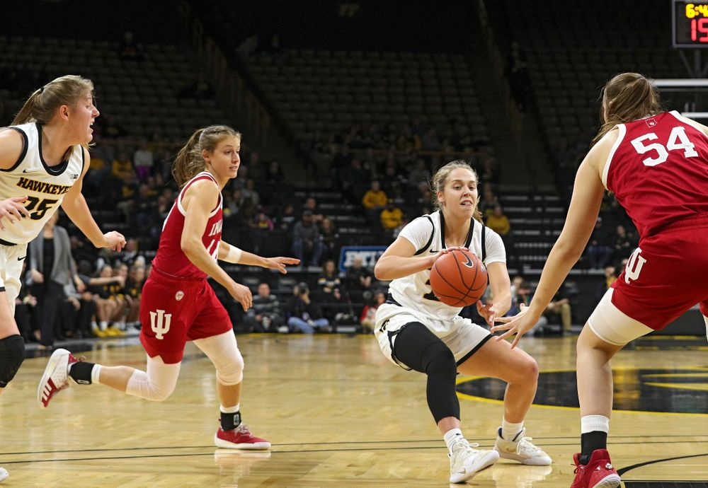Iowa Hawkeyes guard Kathleen Doyle (22) passes the ball for an assist on a score during the first quarter of their game at Carver-Hawkeye Arena in Iowa City on Sunday, January 12, 2020. (Stephen Mally/hawkeyesports.com)