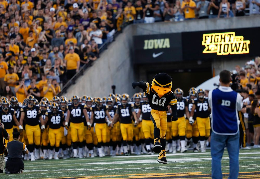 The Iowa Hawkeyes football team swarms the field before a game against Northern Iowa at Kinnick Stadium on September 15, 2018. (Tork Mason/hawkeyesports.com)