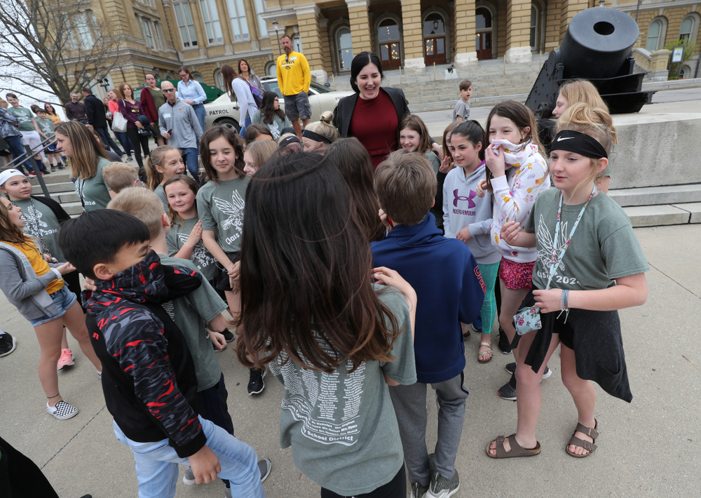 IowaÕs Megan Gustafson takes photos with a group of students on a field trip as she leaves the Iowa State Capitol Wednesday, April 24, 2019 in Des Moines. (Brian Ray/hawkeyesports.com)