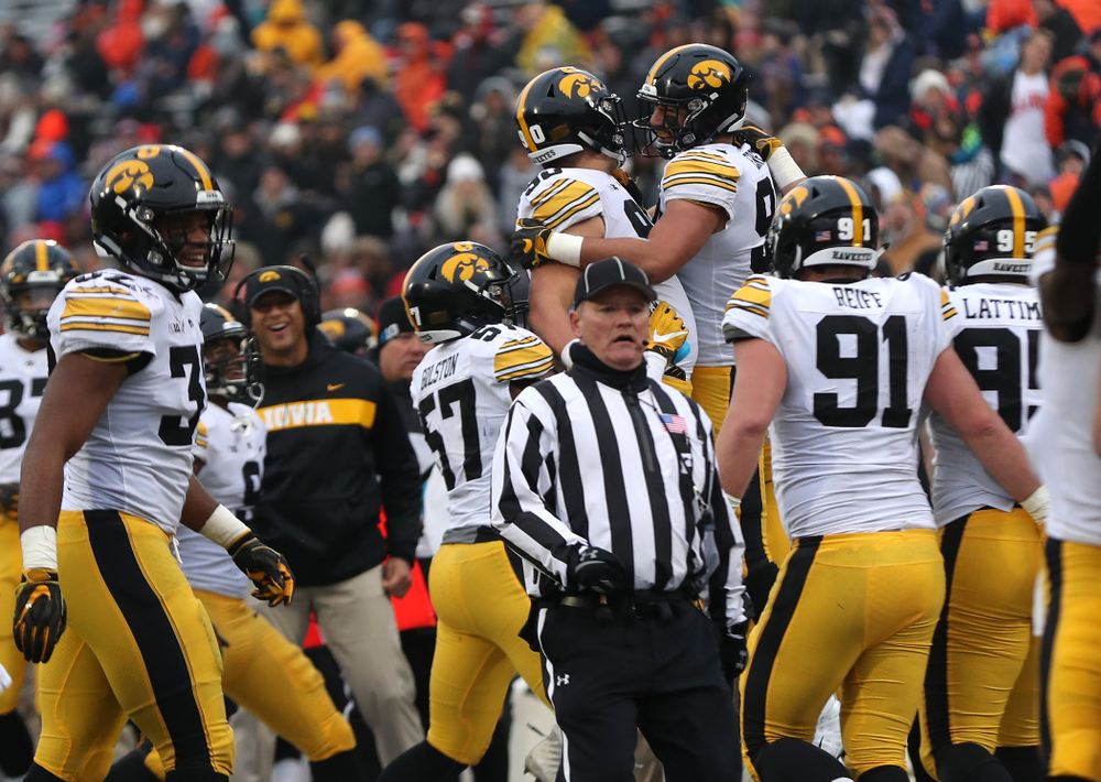 Iowa Hawkeyes defensive end A.J. Epenesa (94) celebrates with defensive end Sam Brincks (90) after blocking a punt against the Illinois Fighting Illini Saturday, November 17, 2018 at Memorial Stadium in Champaign, Ill. (Brian Ray/hawkeyesports.com)