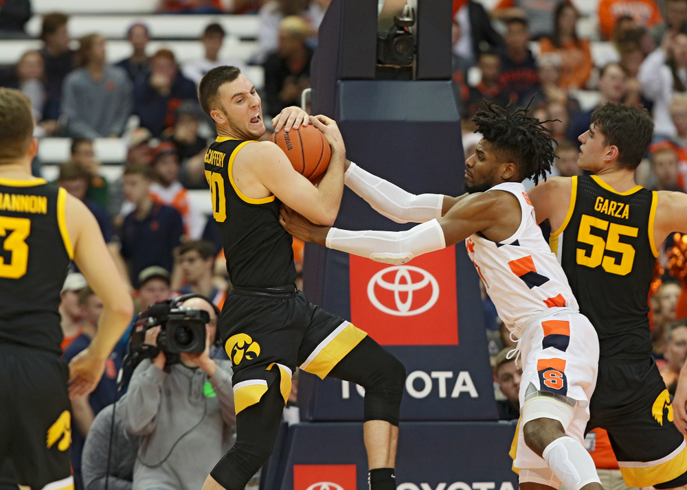 Iowa Hawkeyes guard Connor McCaffery (30) pulls down a rebound during the second half of their ACC/Big Ten Challenge game at the Carrier Dome in Syracuse, N.Y. on Tuesday, Dec 3, 2019. (Stephen Mally/hawkeyesports.com)