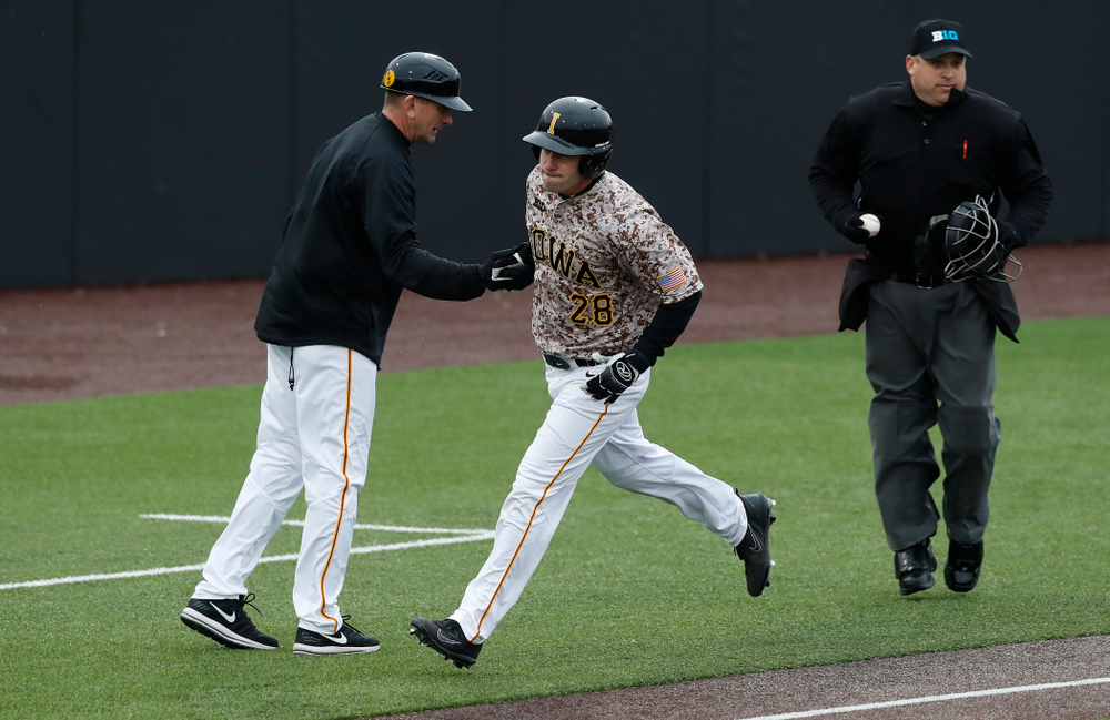 Iowa Hawkeyes infielder Chris Whelan (28) and head coach Rick Heller during a double header against the Indiana Hoosiers Friday, March 23, 2018 at Duane Banks Field. (Brian Ray/hawkeyesports.com)