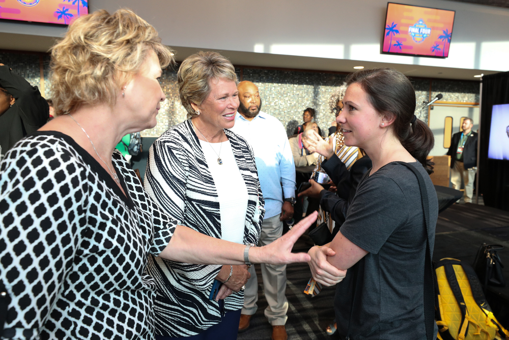 Iowa Hawkeyes head coach Lisa Bluder and director of basketball operations Kathryn Reynolds talk with  Ann Meyers Drysdale following a news conference Thursday, April 4, 2019 at Amalie Arena in Tampa, FL. (Brian Ray/hawkeyesports.com)