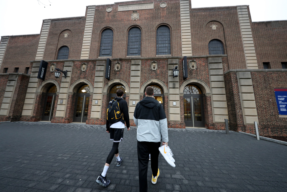 Iowa Hawkeyes forward Patrick McCaffery (22), and guard Connor McCaffery (30) arrive for practice at the Palestra Friday, January 3, 2020 in Philadelphia. (Brian Ray/hawkeyesports.com)
