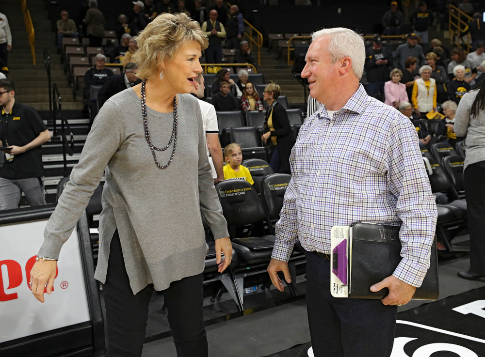 Iowa head coach Lisa Bluder talks with Winona State head coach Scott Ballard before their game against Winona State at Carver-Hawkeye Arena in Iowa City on Sunday, Nov 3, 2019. (Stephen Mally/hawkeyesports.com)