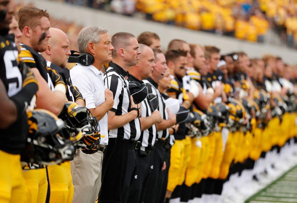 Iowa Hawkeyes head coach Kirk Ferentz stands for the National Anthem against the Northern Illinois Huskies Saturday, September 1, 2018 at Kinnick Stadium. (Brian Ray/hawkeyesports.com)