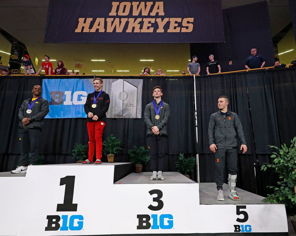 Iowa's Stewart Brown receives a bronze medal for this  third place finish in the vault during the second day of the Big Ten Men's Gymnastics Championships at Carver-Hawkeye Arena in Iowa City on Saturday, Apr. 6, 2019. (Stephen Mally/hawkeyesports.com)