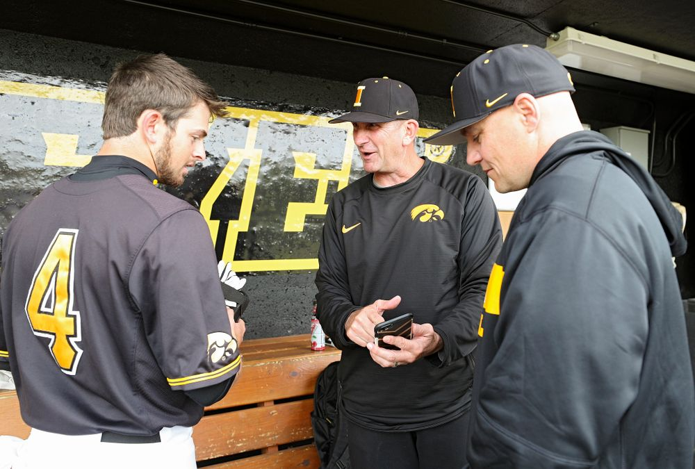 Iowa Mitchell Boe (from left), head coach Rick Heller, and assistant coach Robin Lund at Duane Banks Field in Iowa City on Monday, May 20, 2019. (Stephen Mally/hawkeyesports.com)