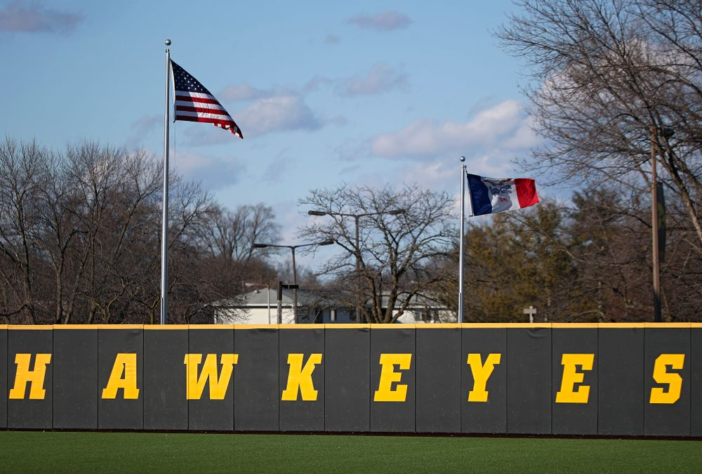 The flag of the United States and the state of Iowa fly during the first inning of the game at Duane Banks Field in Iowa City on Tuesday, March 3, 2020. (Stephen Mally/hawkeyesports.com)
