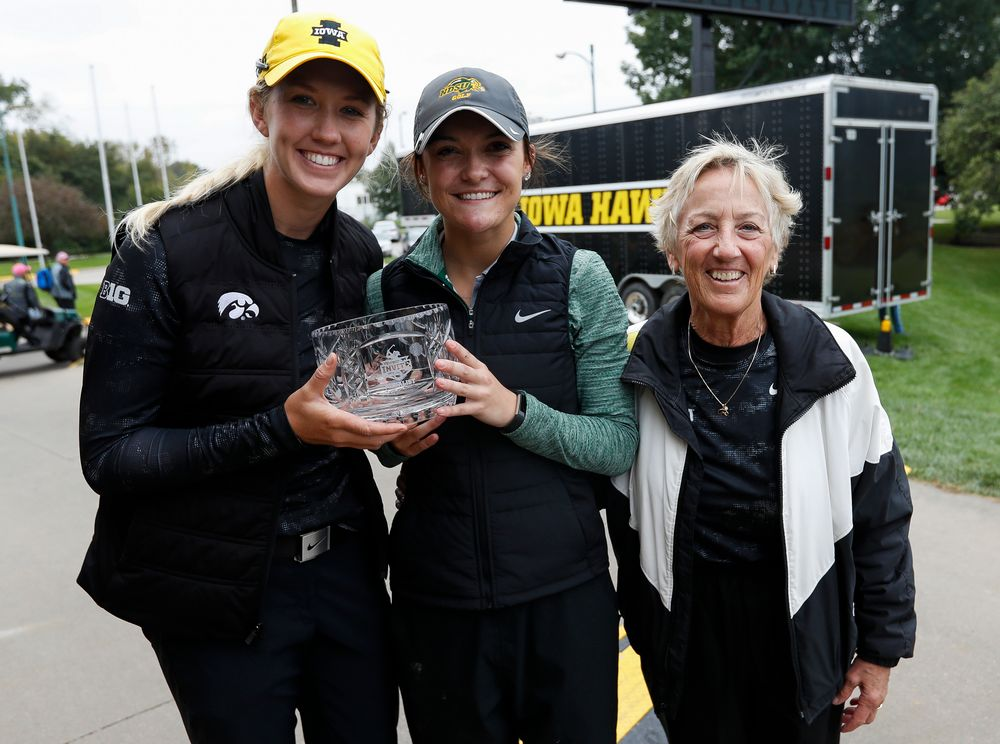 Iowa's Shawn Rennegarbe and North Dakota State's Taylor McCorkle, co-champions of the Diane Thomason Invitational, pose for a photo with former Iowa women's golf head coach Diane Thomason during a post-round awards ceremony after the final round of the Diane Thomason Invitational at Finkbine Golf Course on September 30, 2018. (Tork Mason/hawkeyesports.com)