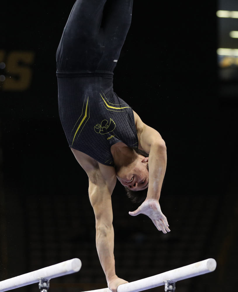 Iowa's Evan Davis competes on the parallel bars against the Ohio State Buckeyes  Saturday, March 16, 2019 at Carver-Hawkeye Arena.  (Brian Ray/hawkeyesports.com)