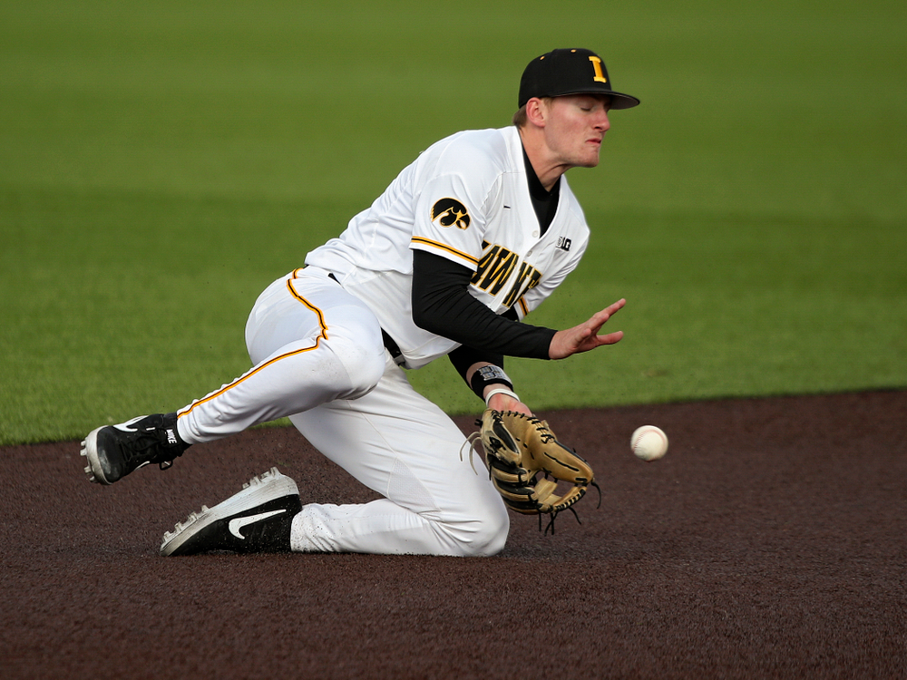 Iowa infielder Brendan Sher (2) fields a ground ball as they turn a double play during the eighth inning of their college baseball game at Duane Banks Field in Iowa City on Wednesday, March 11, 2020. (Stephen Mally/hawkeyesports.com)