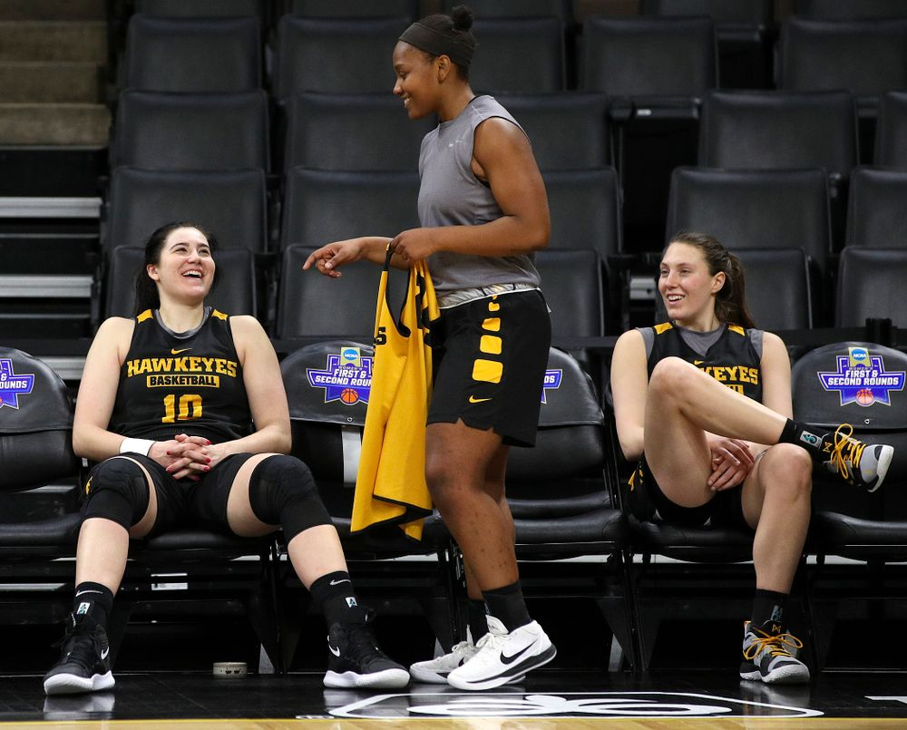 Iowa Hawkeyes forward Megan Gustafson (10), guard Zion Sanders (24), and forward Amanda Ollinger (43) share a laugh at a practice during the 2019 NCAA Women's Basketball Tournament at Carver Hawkeye Arena in Iowa City on Saturday, Mar. 23, 2019. (Stephen Mally for hawkeyesports.com)