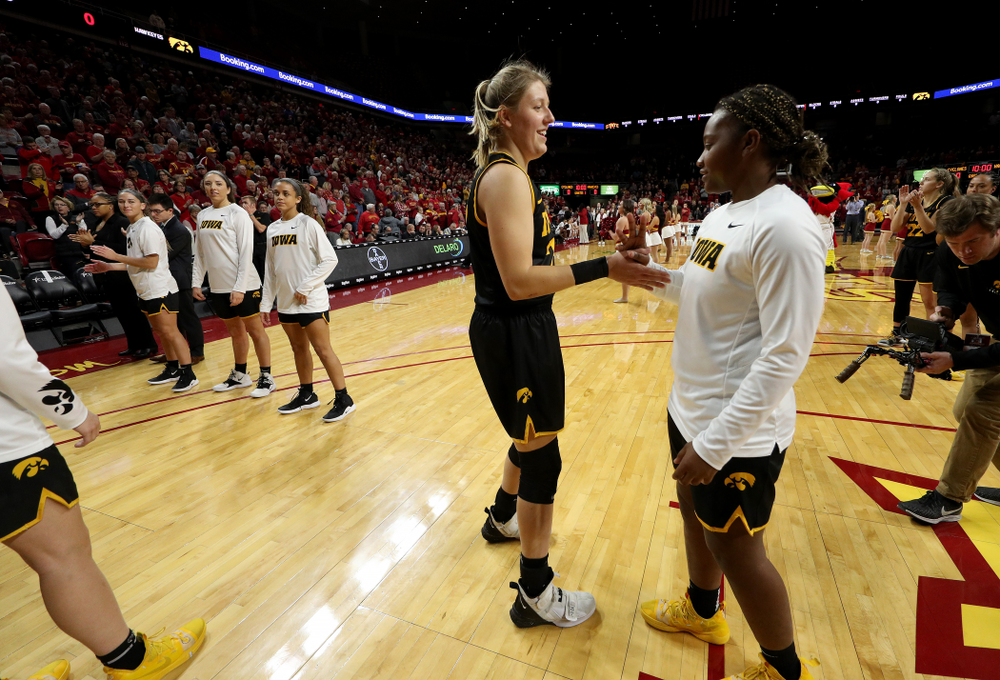 Iowa Hawkeyes forward/center Monika Czinano (25) and guard Zion Sanders (21) against the Iowa State Cyclones Wednesday, December 11, 2019 at Hilton Coliseum in Ames, Iowa(Brian Ray/hawkeyesports.com)