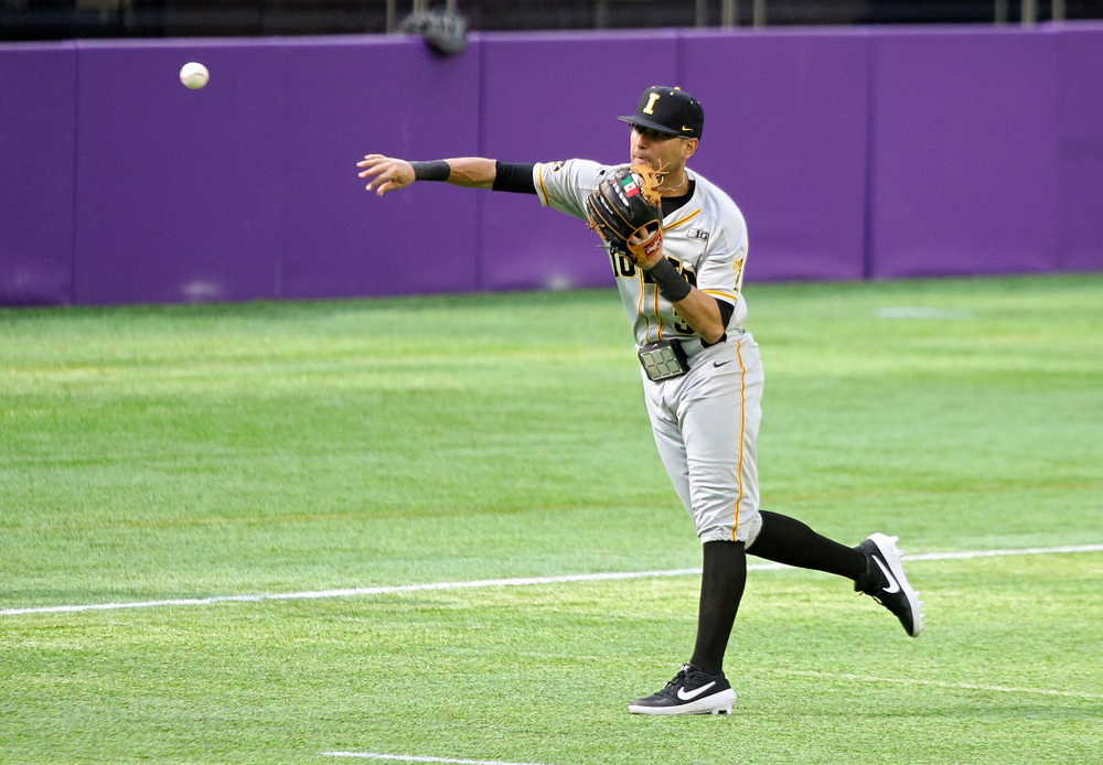Iowa Hawkeyes infielder Matthew Sosa (31) throws to home for an out during the fourth inning of their CambriaCollegeClassic game at U.S. Bank Stadium in Minneapolis, Minn. on Friday, February 28, 2020. (Stephen Mally/hawkeyesports.com)
