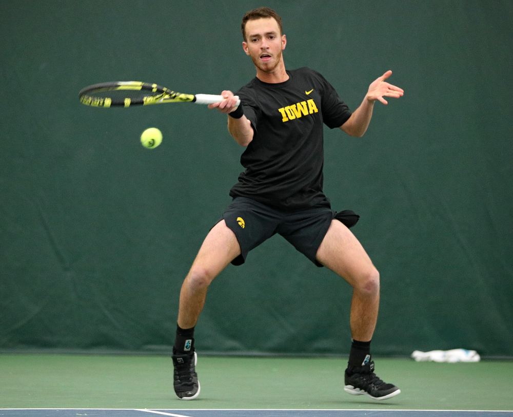 Iowa's Kareem Allaf hits a shot during his match against Marquette at the Hawkeye Tennis and Recreation Complex in Iowa City on Saturday, January 25, 2020. (Stephen Mally/hawkeyesports.com)